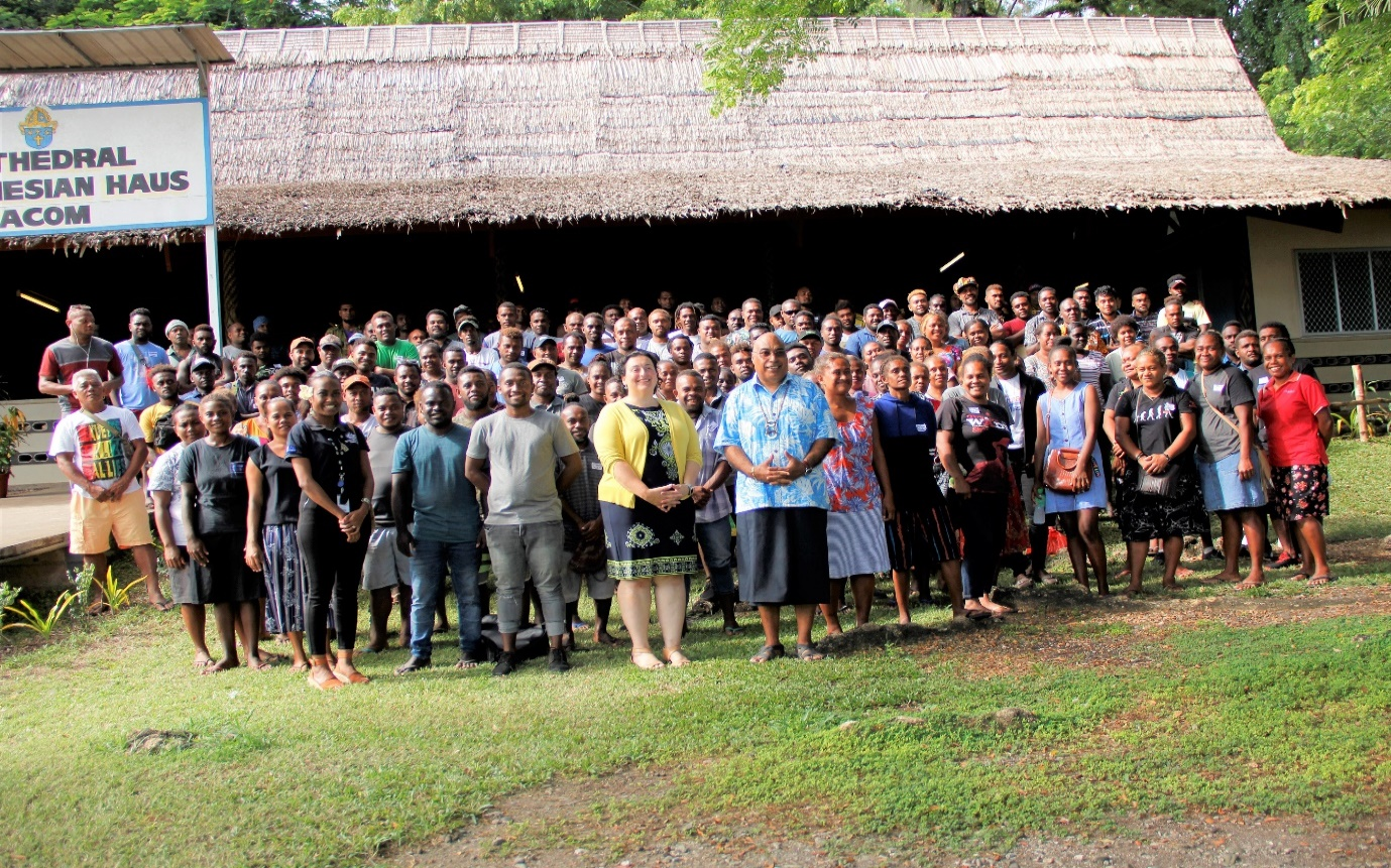 PS Beck and Christina & Vanessa from AHC with the workers after the Pre-departure briefing at St. Barnabas Leaf hut.