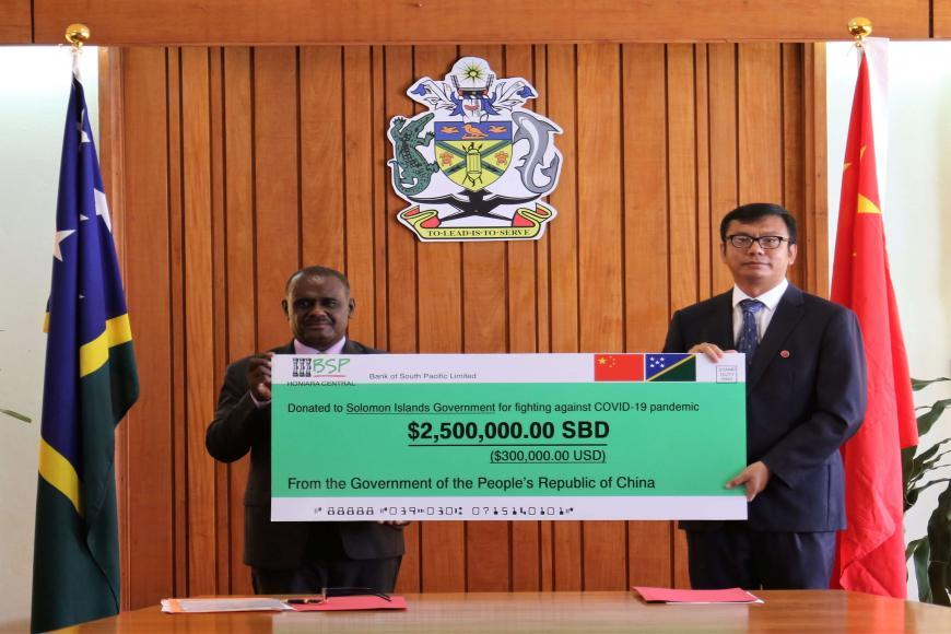 Hon. Manele Receiving the Relief Fund from the PRC Government
